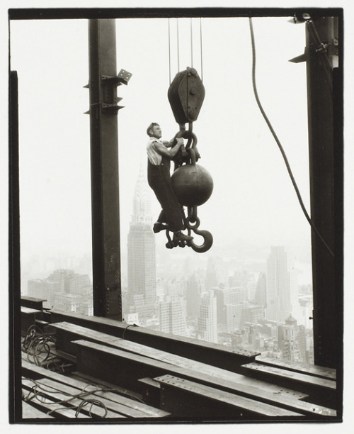 "© Lewis Wickes Hine, ca. 1931, Empire State Building, New York ""You can see the most beautiful things from the observation deck of the Empire State Building. I read somewhere that people on the street are supposed to look like ants, but that's not true. They look like little people. And the cars look like little cars. And even the buildings look little. It's like New York is a miniature replica of New York, which is nice, because you can see what it's really like, instead of how it feels when you're in the middle of it."" (Jonathan Safran Foer)"