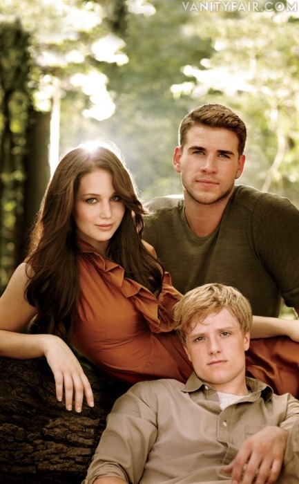 More Hunger Games. Jennifer Lawrence between Liam Hemsworth and Josh Hutcherson. Photograph by Sam Jones. More cast photos!
