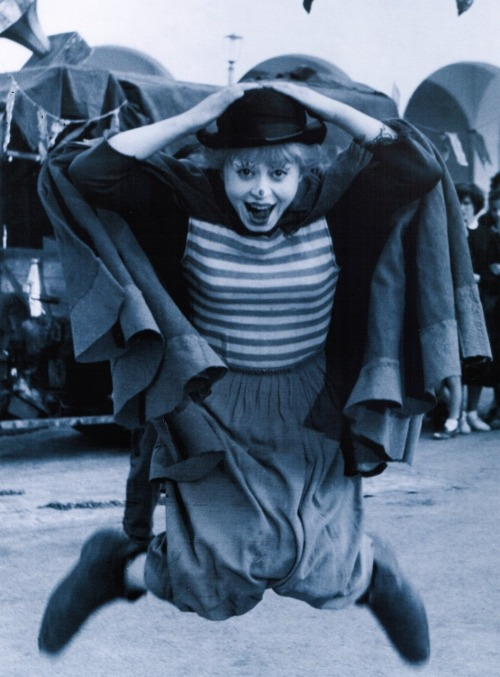 "Giulietta Masina on the set of La Strada (1954, dir. Federico Fellini) (via) ""Mr. Fellini says that his wife sometime resists his view of her talents, which he summarizes as 'a mingling of youngish and clownish.' But make no mistake: in suggesting that his wife is a clown, Mr. Fellini means no insult. 'The clown is the aristocracy of acting,' he says. 'To be a clown means to have the possibility of making people cry and laugh.' (via)"