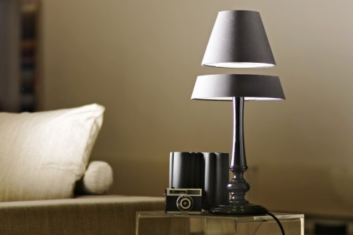 enochliew:  Silhouette Floating Lamp by Angela Jansen While the upper part levitates using electromagnets, the lower section is home to a ring of LEDs that reflect off the suspended mirror above to throw light out into the room.