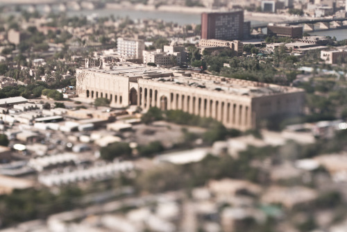 Baghdad: A Model City (9/12) Since the US invasion of Iraq eight years ago, I've been to Baghdad eight times. I first arrived in the city as a US Marine in April 2003 with the invading forces. I've returned as a journalist on seven more occasions. I've witnessed Baghdad morph and contort like no other city: from the open, uncertain, early days of the occupation to ground zero of a bloody civil war to a labyrinth of cement T-walls that give inhabitants the feeling of rats in a maze never finding the cheese. This series of aerial, tilt-shift photos offers a glimpse of Baghdad's unbounded future—a hope for a new Baghdad: a model city known for its own treasures instead of the violence unleashed by the course of recent history. As the US military withdraws, this scarred city is tentatively blossoming anew. Tourist attractions like the 180-foot-high ferris wheel ask visitors to see Baghdad as something other than a battleground and recognize that the last eight years are but a single grain joining three thousand years of sand in the base of Baghdad's ancient hourglass. See this series on exhibition at FotoWeek DC beginning Nov. 5.