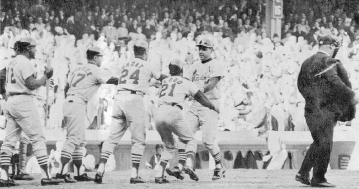 Teammates welcome Cardinals third baseman Ken Boyer as he reaches home on a sixth-inning grand slam homer on Oct. 11, 1964, in Game 4 of the World Series against the Yankees. Greeting him are Cari Warwick, Dick Groat and Curt Flood, all of whom were on base when Boyer hit the homerun. At left is Bill White, the next batter. Boyer's blast put the Cardinals in front, 4-3 at the time. The Yankees were not able to recover; the Cardinals won the game 4-3, and won the Series. Boyer is among 10 candidates for baseball's Hall of Fame. (Photo by the Associated Press)  See more photos »