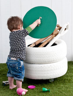 Turn Old Tires into a Storage Bin via Curbly | DIY Design Community  The most original use for an old tire I have seen yet. This would be extremely simple to make as well. A flat lid with a handle, and some salvaged castors and your old tires have a new lease on life. Author's note: A very good cleaning and a couple coats of low VOC paint should make the tires safe for in home use. (I do not recommend bringing them inside without sealing them) Author's second note: If you are too scared to use these inside (And I understand completely) I am sure you have toys outside that could be rounded up with one or more of these.