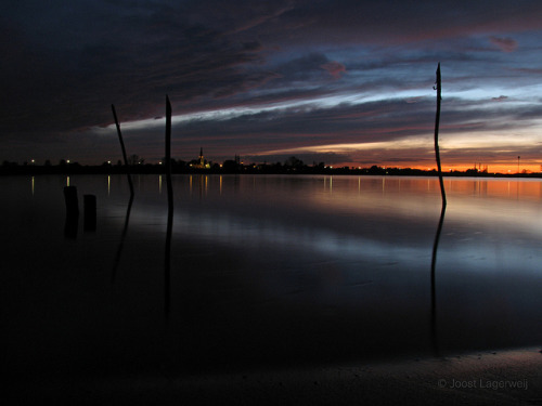 Night and Day on Flickr.Sunset by the river Lek in the Netherlands