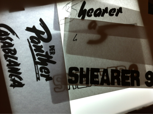Trying to sketch out a Shearer logo using old cinema fonts as a starting point.