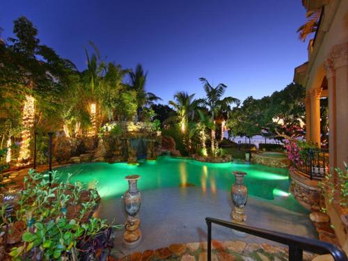 A most magnificent tropical pool, complete with waterfall, with a view of the Gulf of Mexico (via A Mediterranean Mansion with Moorish Flair [33 pics])