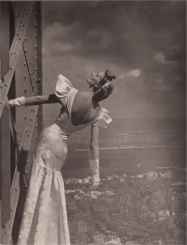 wehadfacesthen:  Model wearing Mainbocher dress at the Eiffel Tower, Harper's Bazaar, 1939
