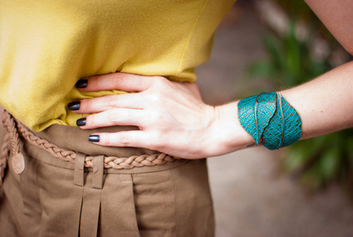 It's all in the details!  Braided belts, bright jewelry, brooding nails…we want.