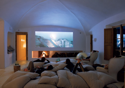 myidealhome:  the perfect weekend: fireplace + tons of pillows + home cinema (via Man Cave With a View - NYTimes.com)