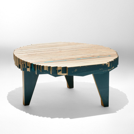 The Petroglyph Table by Nucleo is made from discarded pieces of plywood of varying lengths.  via SoFiliumm