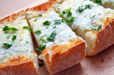 hellyeahrecipes:  Gorgonzola Garlic Bread 1/4 cup butter, room temperature  1/2 cup gorgonzola dolce, room temperature  2 cloves garlic, grated  1 tablespoon parsley, chopped  1 loaf Italian bread, cut in half  1/2 cup parmigiano reggiano (parmesan), grated Cream the butter and gorgonzola and then mix in the garlic and parsley. Spread the mixture over the bread, top with the parmigiano reggiano and broil until golden brown.