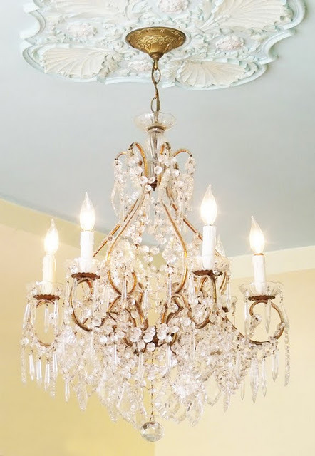 Love this ornate chandelier, and the moulded ceiling medallion it hangs from (via Mod Vintage Life: chandeliers)