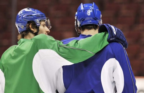klovharun:  Ryan Kesler and Taylor Pyatt. This was Pyatt's first practice back with the team after losing his fiance in a tragic car accident.