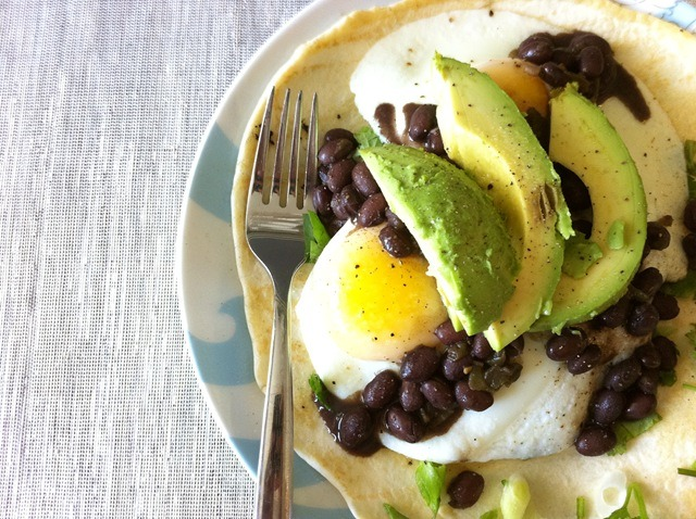 gastrogirl:  fried eggs with spicy black beans and avocado.