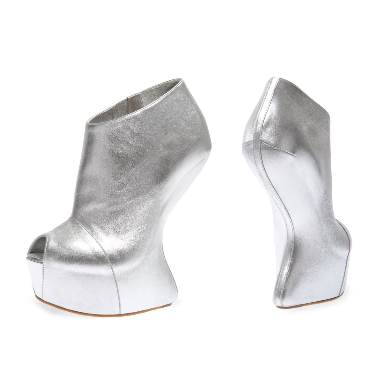 glitternheels:  Giuseppe Zanotti - Silver Ankle Boot with curved wedge. (FW 11-12)