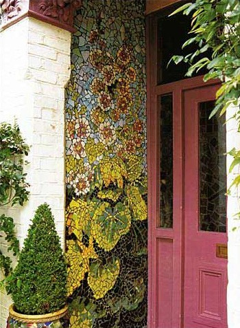 Intricate mosaic graces the front entryway of this home Mosaic created by Kaffe Fassett (via Outdoor Spaces )