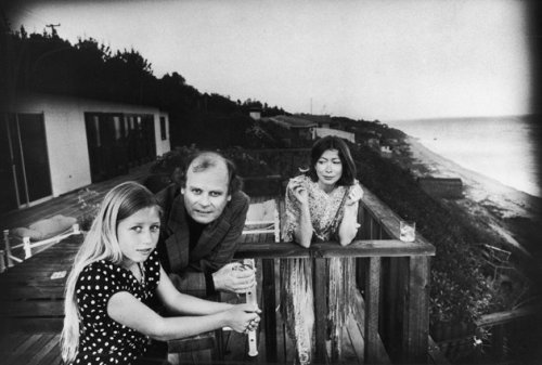 "Quintana Roo Dunne, John Gregory Dunne, and Joan Didion, Malibu, California, 1976  Blue Nights is a story of loss: simple, wrenching, inconsolable loss. The absence of Quintana becomes the most present thing in Didion's life. ""We tell ourselves stories in order to live,"" Didion famously wrote in The White Album. Blue Nights is about what happens when there are no more stories we can tell ourselves, no narrative to guide us and make sense out of the chaos, no order, no meaning, no conclusion to the tale. The book has, instead, an incantatory quality: it is a beautiful, soaring, polyphonic eulogy, a beseeching prayer that is sung even as one knows the answer to one's plea, and that answer is: No. via The New York Review of Books - 'Elegy to the Void' by Cathleen Schine"