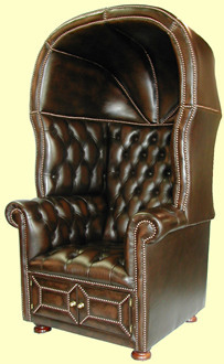annienomiss:  Buttoned leather Chesterfield porter's chair. It has storage space underneath the seat. 3/4 front view. Aka dome chair.