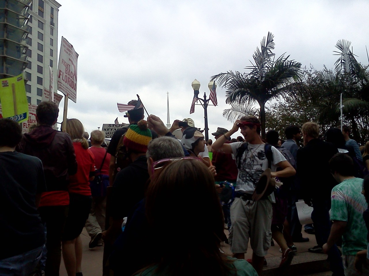 Occupy Orlando Finally got a chance to take part in an Occupy march this morning! I have been to Occupy Orlando a few times over the last couple weeks, including almost the entire first day and still had managed to miss marching every time until now. So glad that I was able to be a part of this today, very powerful. Great people and good vibes. It is interesting how, while there are certain things that everyone is involved with and the movement agrees on to some extent, the ideas can also be extremely varied. It's refreshing to see that people can bond over their similarities and address their differences with civility. I'm sure there are exceptions, but that is the approach I have seen every time that I have been there. A lot of people criticize the Occupy movement because of a lack of focus. Sometimes, I agree with this, but I have to say that my opinion changes like the weather. However, I always will disagree with those that say there is NO POINT to all of the demonstrations, because to me it is important just to bring attention to the fact that there are very big problems around the world. It is important to demonstrate that we aren't apathetic. Between the late hour and the little sleep I had the night before I know this wasn't exactly concise, but I really felt the need to write or ramble something before I turned in for the the night.