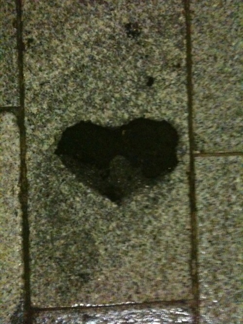 A black heart on the street, an empty space on someone's face