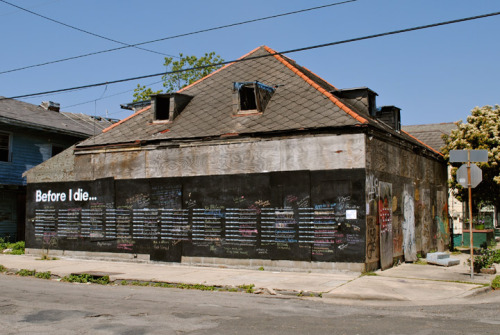 "thedailyrandomblog:  Before I Die… An abandoned house in New Orleans (possibly the one mentioned in The Eagles song, but we have no idea) has been transformed into a giant chalkboard where residents can write on the wall and remember what is important to them - next to the words ""Before I die I want to ………"". Take a look at the photo's, and read more about the project at CandyChang.com"