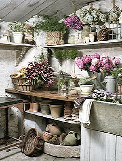 Beautiful potting shed full of flowers, with an enviable stone sink and wooden ceiling (via Brabourne Farm: Pottering About)
