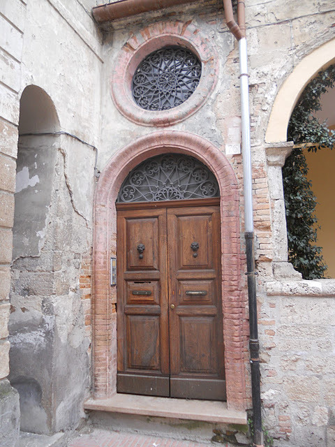Old door and windows in Campli, Italy (via European Chic: Italian Impressions V)