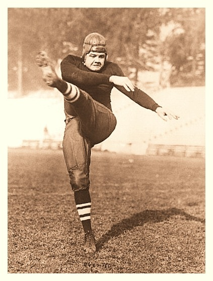 Babe Shows Off His Football Skills Babe Ruth dons a rather unfamiliar uniform and gives a high kick for the camera. Taken ca.1920's.