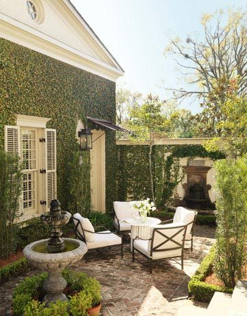 "The patio was inspired by the intimate, romantic courtyards in the French Quarter. ""It's totally hidden from street view, so it creates a sense of privacy and mystery,"" says designer Ty Larkins. (via Outdoor Room Design Ideas - Photos of Outdoor Rooms - House Beautiful)"