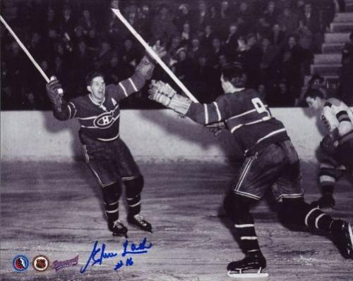 "Elmer Lach and Maurice ""Rocket"" Richard celebrate while some unknown Bruins guy feels sad about not wearing a helmet while playing a very dangerous game."