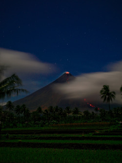 Mayon volcano erupting at night