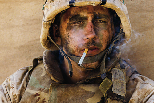 "USMC soldier James Blake Miller, dubbed the ""Marlboro Marine"" by the media, smoking a cigarette while serving in Iraq during the Battle of Fallujah. Upon returning to the USA from service in 2005 he married his fiancée, but he suffered from PTSD due to his service, which put a strain on their relationship. A year after getting married they were in the process of a divorce. Miller now suffers from depression and is involved in a motorcycle gang."