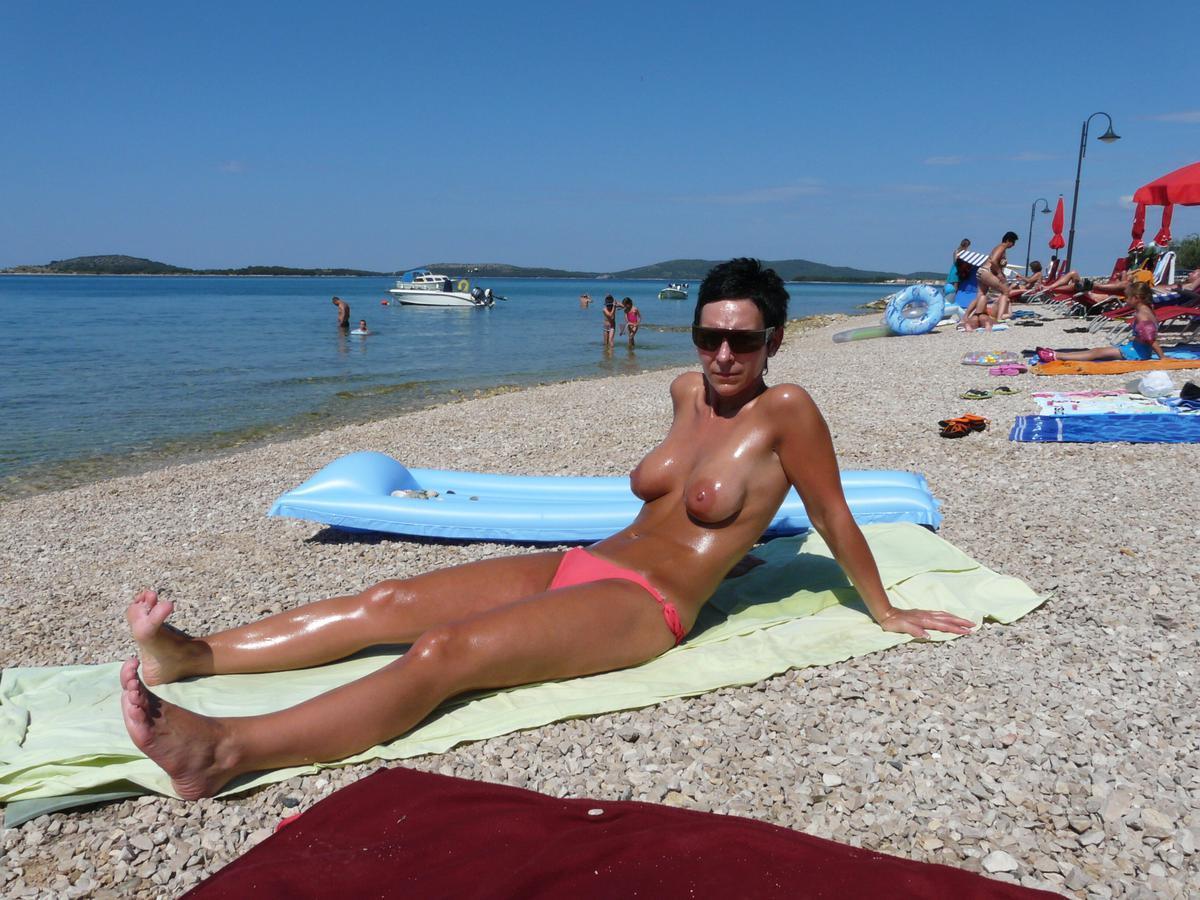 Back yard nude sunbathing captions