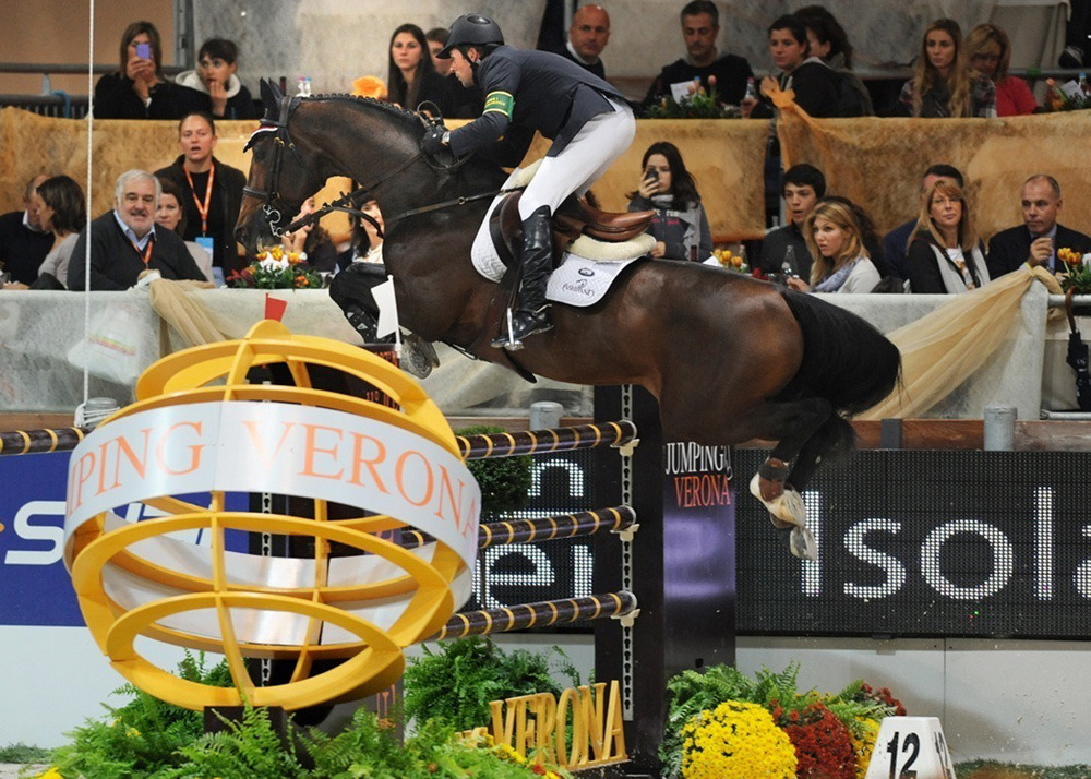 "nationalpostsports:  Gold medal horse Hickstead deadHickstead, the ""superstar"" stallion that carried Canadian equestrian champion Eric Lamaze to Olympic gold-medal glory in Beijing in 2008, died suddenly during a competition in Italy on Sunday, tragically ending a partnership that helped push the country to the top of the sport of show jumping.Montreal-born Lamaze, the world's current No. 1 rider, had just taken Hickstead through a nearly faultless 13-fence course at the Rolex FEI World Cup in Verona, Italy, when the 15-year-old horse abruptly collapsed and died.""We finished our round, I circled and was leaving the ring, and he collapsed and died of an apparent heart attack,"" Lamaze said in a news release. ""It is the most tragic thing that has ever happened. We had him until he was 15, and we had a great time together. He was the best horse in the world. We are all devastated."" (Photo: BRUNO DE LORENZO/AFP/Getty Images)"