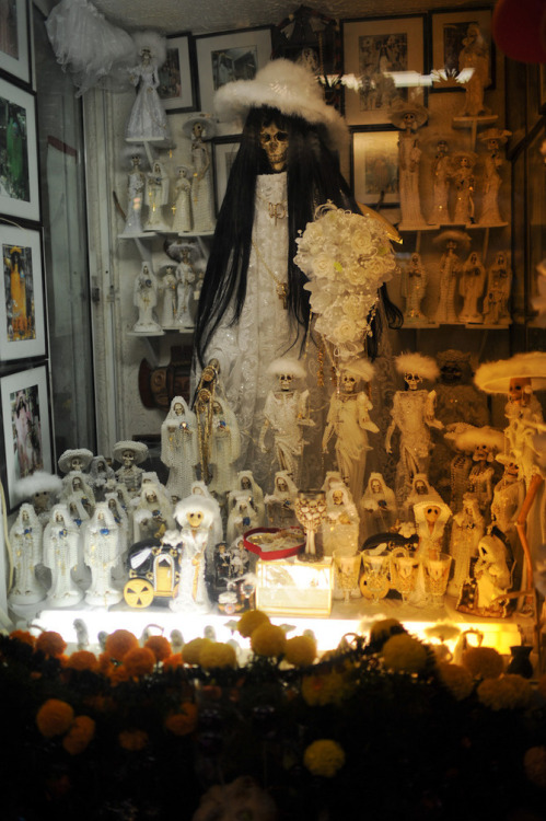 viceuk:  TEPITO, MEXICO'S GRIM REAPER SAINT On November 2nd, Day of the Dead, all of Mexico visits graveyards and brings gifts like flowers, bread, and alcohol to the relatives that have passed away. But in Tepito, one of the most dangerous neighborhoods in Mexico City, on the first day of every month people gather at an altar to pray to Holy Death herself.