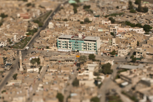 Baghdad: A Model City (12/12) Since the US invasion of Iraq eight years ago, I've been to Baghdad    eight times. I first arrived in the city as a US Marine in April 2003    with the invading forces. I've returned as a journalist on seven more    occasions. I've witnessed Baghdad morph and contort like no other city:    from the open, uncertain, early days of the occupation to ground zero   of  a bloody civil war to a labyrinth of cement T-walls that give    inhabitants the feeling of rats in a maze never finding the cheese. This series of aerial, tilt-shift photos offers a glimpse of    Baghdad's unbounded future—a hope for a new Baghdad: a model city known    for its own treasures instead of the violence unleashed by the course    of recent history. As the US military withdraws, this scarred city is    tentatively blossoming anew. Tourist attractions like the  180-foot-high   ferris wheel ask visitors to see Baghdad as something  other than a   battleground and recognize that the last eight years are  but a single   grain joining three thousand years of sand in the base of  Baghdad's   ancient hourglass. See this series on exhibition at FotoWeek DC beginning Nov. 5.