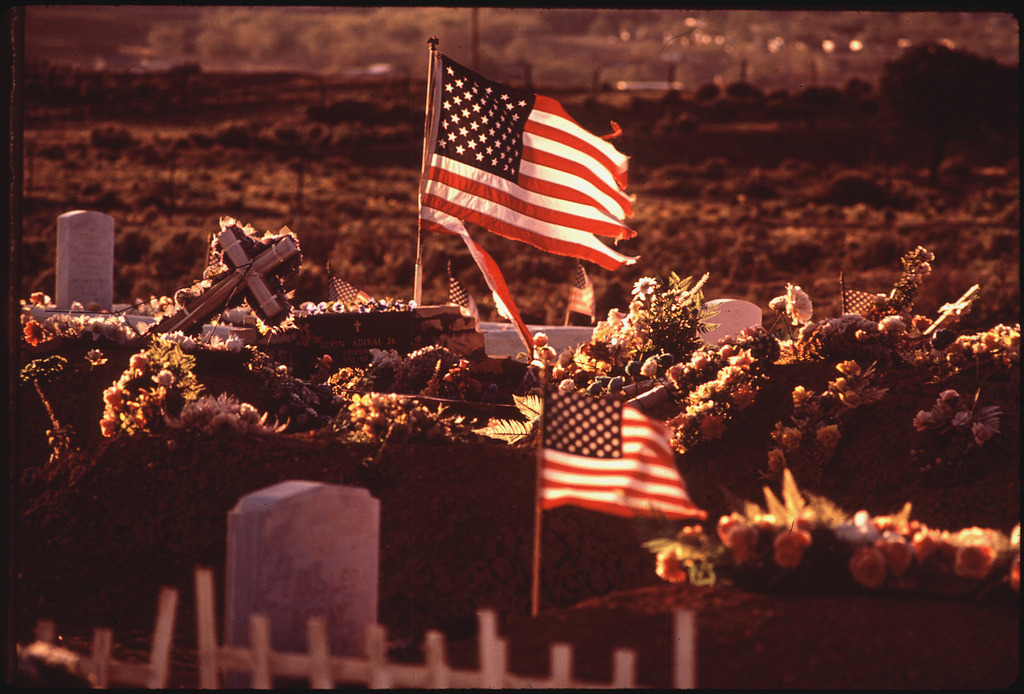 Image description: This photograph was taken in May 1972 at a veterans cemetery in Window Rock, Arizona. Photo by Terry Eiler from the Documerica Project collection at the U.S. National Archives. Eiler photographed work and homes on Navajo and Hopi reservations in Arizona.