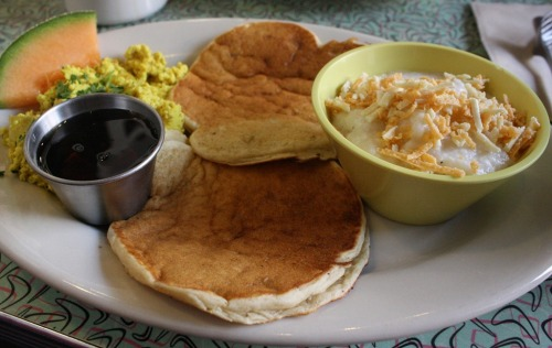 What's for brunch? Hm, let's see now. Vegan pancakes with grade B maple syrup, grits with vegan cheese, simple delicious tofu scramble made with olive oil, salt & freshly ground pepper, garnished with fresh cilantro and a slice of cantaloupe. I'd have all this with an almond macchiato. Photo courtesy: thewannabechef