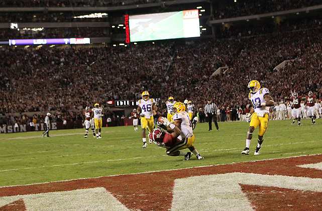 LSU safety Eric Reid intercepts a pass intended for Alabama tight       end Michael Williams in the fourth quarter of Saturday's game between the Tigers and Crimson Tide. Williams initially appeared to make the catch but Reid snatched the ball away as both players hit the ground. The Tigers won the game in overtime, 9-6. (Damian Strohmeyer/SI) MANDEL: Despite lack of offense, LSU proves they are the nation's top teamMANDEL: LSU-OSU in BCS leads SI.com's latest complete bowl projectionsMcCARTNEY: Did Richardson blow Heisman chances in LSU-Alabama matchup?GALLERY: College Football Top 25 Review | Heisman Watch: Week 10