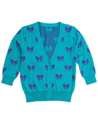 Style tip: Add some fun to your wardrobe with a sweater in a playful pattern, like this colorful, bow-printed cardigan from Delia's.  See more options in our guide to 100 stylish cardigans for fall »
