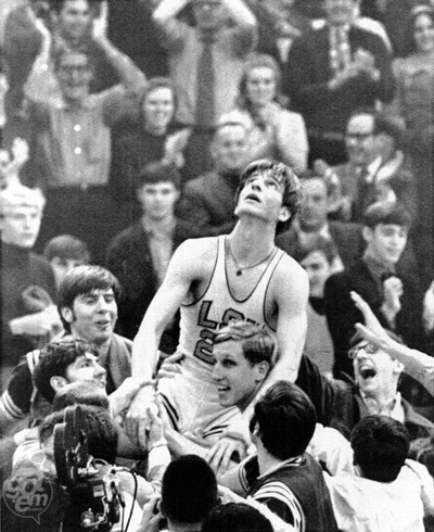 "gotemcoach:  GODDAMN: The Pistol breaks the NCAA scoring record This photo was taken after Pete Maravich passed Oscar Robertson on the career college scoring list.  Maravich is still first on the list, with 3,667 points, and likely never to be passed.  His closest competitor (Freeman Williams, '74-'78) is over 400 points behind him. But here's the rub… Pete Maravich was a freshman at Louisiana State University in 1966.  At that time, freshman could not play varsity basketball.  The Pistol scored 3,667 in just 3 seasons, averaging 44.2 points per game, for his career (also an NCAA record). Oh, and just one more thing: when Pistol Pete played college basketball, there was no 3-point line.  Sam King, who covered LSU for the Baton Rouge State-Times studied play-by-play charts of Maravich's senior season and determined the Pistol averaged 7.2 baskets per game, behind what would have been the college 3-point line.  That's an extra 7+ points each game, which would have pushed his average above 50 per contest. Chew on that. @gotem_coach  Pistol Pete had some of the most insane college stats ever. He averaged over 44 points per game, but also had almost six assists per game, and AVERAGED a whopping 38 shots per game. The ball was in his hands constantly. To put this in perspective, the second guy on the scoring list, Freeman Williams (better known as pickup basketball legend Duck Johnson in ""White Men Can't Jump"") played four years in college - but put up 250 fewer shots. Pistol Pete took 1200 more shots than fourth-place Oscar Robertson did in his three-year college career - Robertson shot 53.5% from the field; Pete was only at 43.8%. Which leads to two conclusions: 1. Pistol Pete was incredible at getting off a shot, and the degree of difficulty of some of those efforts hurt his percentages. 2. If you are a 44% shooter, and you want 38 shots per game, it really helps if your dad is the basketball coach."