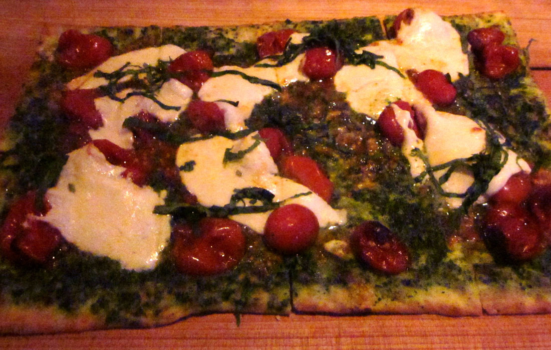 """The Original"" Flatbread at The Scout Waterhouse + Kitchen in Chicago, Illinois Basil Pesto, Roasted Cherry Tomatoes & Whole Milk Mozzarella topped Fresh Basil. I really loved everything about this place. If I ever open a bar or restaurant, I'd definitely take some cues from this place. Good food, long drink list, and just an overall cool vibe. I wish we found this place on night one, instead of going to the South Loop Club, which also served food til 2am. Wouldn't have made up for losing my favorite hoodie, but it would have counted for something."
