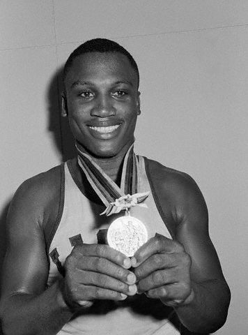 Boxing legend Joe Frazier with the gold medal he earned at the Olympic Games in Tokyo in October 1964. Rest in peace Mr. Frazier.