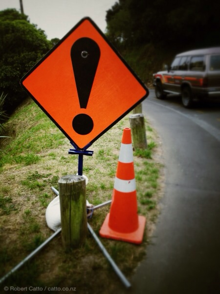 Highly specific New Zealand road sign, warning of general disturbance ahead. May mean anything from 'gardening', to 'riot in progress', to 'road ends abruptly'. Pronounced 'waaaaah', and followed by sound of metal crumpling. I love these.