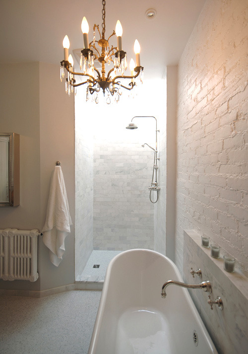 Elegant white on white… this bathroom layers white tones, with painted brick, marble tiles, white fixtures a chandelier. Follow the link to see more photos of this amazing before and after bathroom renovation… it does not even look like the same room (via before & after: elegant bathroom makeover | Design*Sponge)