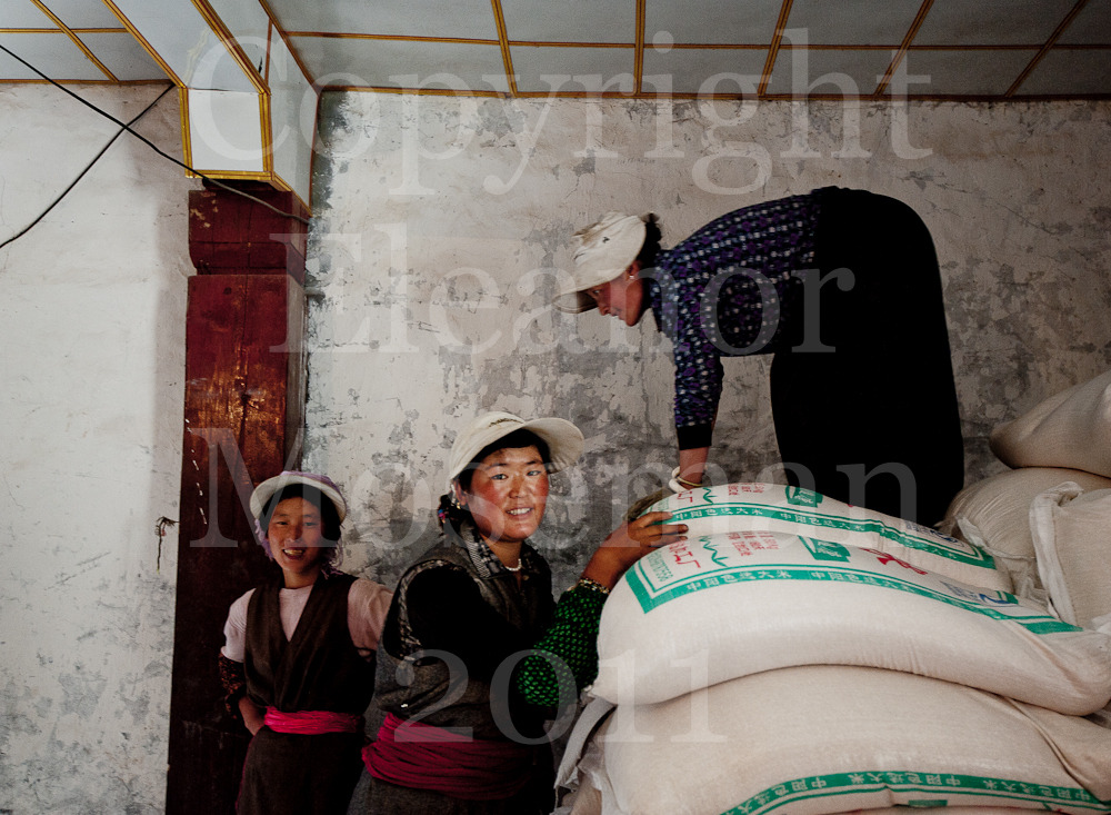 Tibetan Women Loading Grain, Yunnan China 2011