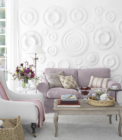 Using ceiling medallions to decorate a plain wall adds interest and texture… this white space is further kicked up with slipcovers and pillows in bright but soft pastel hues (via Home Makeover Ideas - Before and After Home Makeovers - Country Living)
