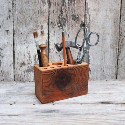 Desk caddy The Original rustic reclaimed wood by PegandAwl Desk Caddy is made from antique wood joists from Philadelphia in the 1800s. It is Olde Growth Pine. The grain is super tight. 7 holes of various sizes are situated in this block for pens, pencils, paintbrushes and other small tools to help keep your work space in order.