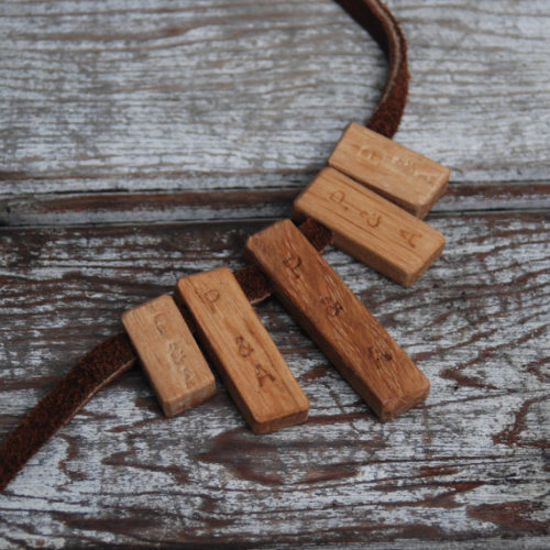woooodit:  Green Botanical Necklace Reclaimed Oak and Leather by PegandAwl A gathering of 5 bits that were abandoned scraps having once belonged to a cabinet maker, given new life. The wood is Oak.