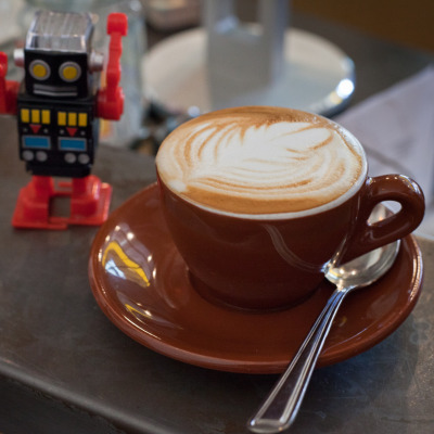 Latte and a robotic friend at Grand Coffee, 2663 Mission Street, San Francisco, CA 94110, San Francisco, CA.